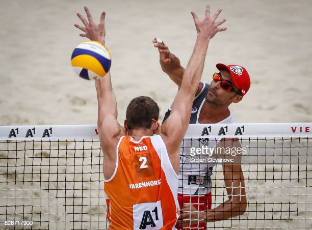 Pablo Herrera of Spain spikes the ball against Christiaan Varenhorst of Netherlands during the Men's Quarterfinal match between Netherlands and Spain...