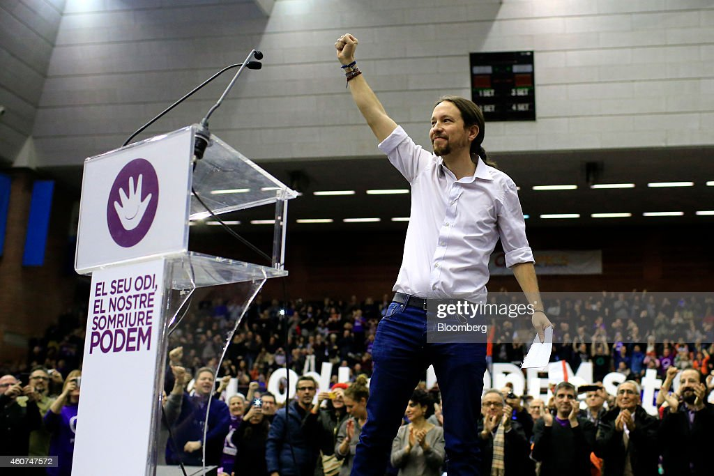 Pablo Iglesias, secretary general of the Podemos party, gestures as he begins to speak at a party conference in Barcelona, Spain on Sunday, Dec. 21, 2014. Podemos, we can in Spanish, formed in the past year and already has wider support than the ruling Peoples Party and the main opposition group, the Socialists, according to a state-run poll released this month. Photographer: Pau Barrena/Bloomberg via Getty Images