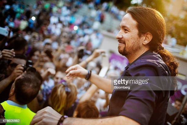 Pablo Iglesias the leader of antiausterity party Podemos greets supporters following his speech at 'The Way To Change' meeting in Badalona Spain on...