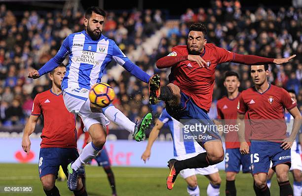Pablo Insua of CD Leganes clashes with Emmanuel Riviere of CA Osasuna during the La Liga match between CD Leganes and CA Osasuna at Estadio Municipal...