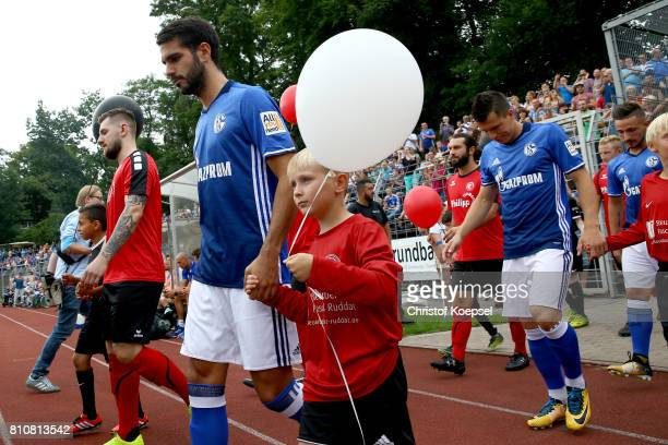 Pablo Insua of Schalke enters the pitch prior to the preseason friendly match between SpVgg Erkenschwick and FC Schalke 04 at Stimberg Stadium on...