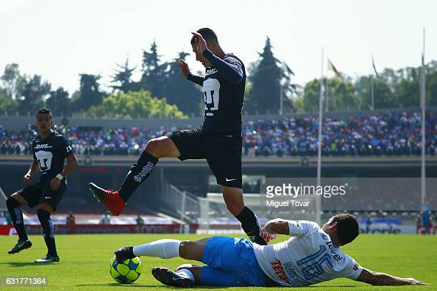 Pablo Jaquez of Pumas fights for the ball with Adrian Aldrete of Cruz Azul during the 2nd round match between Pumas UNAM and Cruz Azul as part of the...