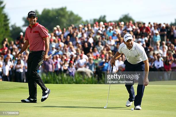 Pablo Larrazabal and Sergio Garcia of Spain joke as they play the first playoff hole during the final round of the BMW International Open at Golfclub...