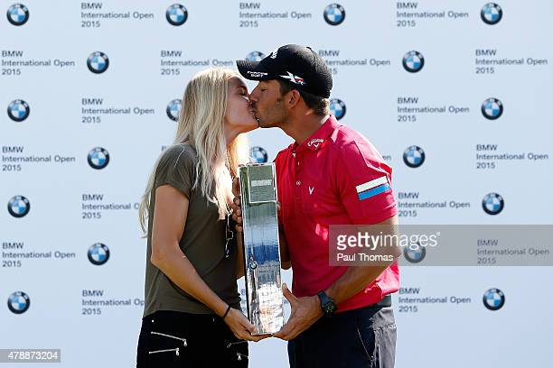 Pablo Larrazabal of Spain celebrates with the trophy and girlfriend Gala Ortin during the BMW International Open day four at the Eichenried Golf Club...