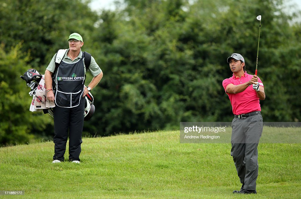 Pablo Larrazabal of Spain hits his second shot on the ninth hole as his caddie <a gi-track='captionPersonalityLinkClicked' href=/galleries/search?phrase=John+Curtis&family=editorial&specificpeople=550280 ng-click='$event.stopPropagation()'>John Curtis</a> looks on during the third round of the Irish Open at Carton House Golf Club on June 29, 2013 in Maynooth, Ireland.