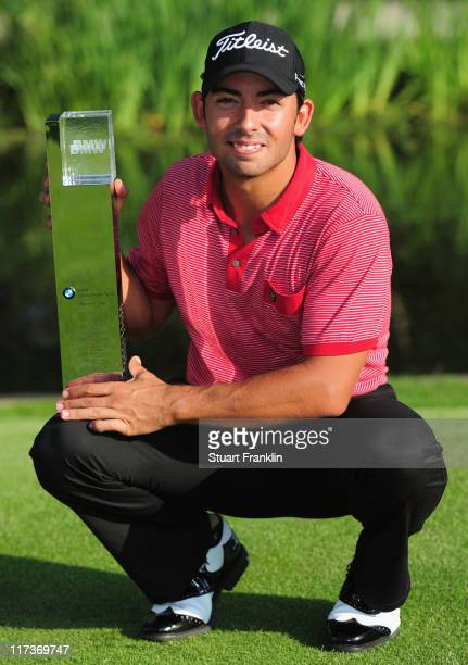 Pablo Larrazabal of Spain holds the trophy after winning the playoff against Sergio Gracia of Spain after the final round of the BMW International...