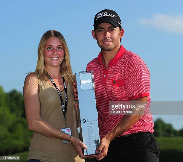 Pablo Larrazabal of Spain holds the trophy with his girlfriend Gala Ortin after winning the playoff against Sergio Gracia of Spain after the final...