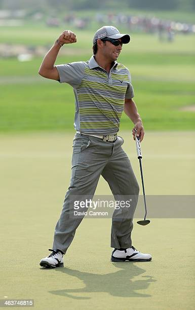 Pablo Larrazabal of Spain holes the winning putt on the par 5 18th green during the final round of the 2014 Abu Dhabi HSBC Golf Championship at Abu...