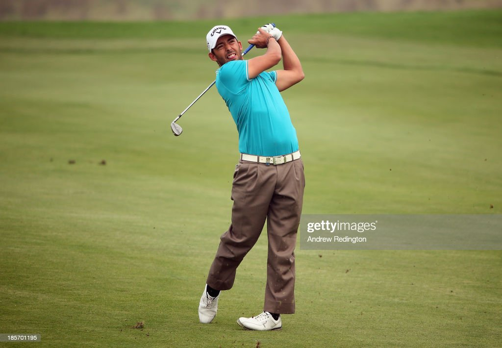 Pablo Larrazabal of Spain in action during the first round of the BMW Masters at Lake Malaren Golf Club on October 24, 2013 in Shanghai, China.