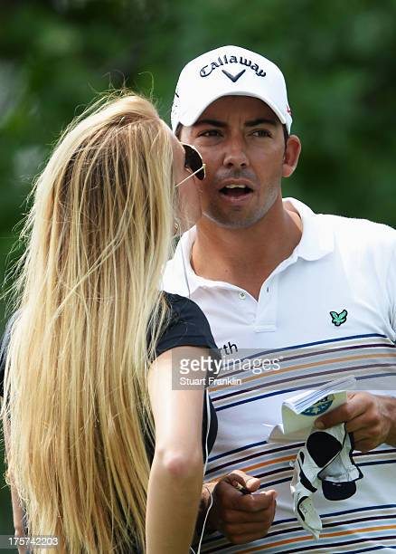 Pablo Larrazabal of Spain is kissed by girlfriend Gala Ortin during a practice round prior to the start of the 95th PGA Championship at Oak Hill...