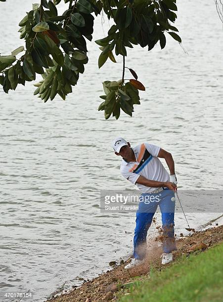 Pablo Larrazabal of Spain plays a shot from near the water on the 17th hole during the third round of the Shenzhen International at Genzon Golf Club...