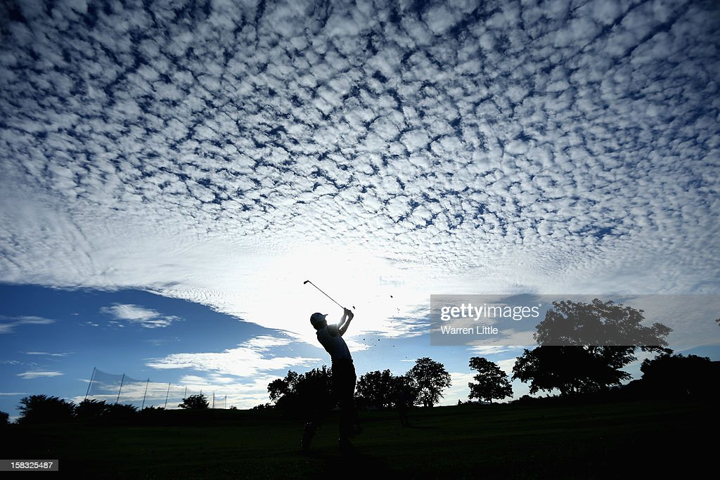<a gi-track='captionPersonalityLinkClicked' href=/galleries/search?phrase=Pablo+Larrazabal&family=editorial&specificpeople=4022842 ng-click='$event.stopPropagation()'>Pablo Larrazabal</a> of Spain plays his second shot into the 18th green during the first round of the Alfred Dunhill Championship at Leopard Creek Country Golf Club on December 13, 2012 in Malelane, South Africa.