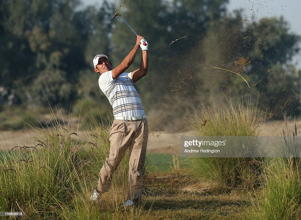 <a gi-track='captionPersonalityLinkClicked' href=/galleries/search?phrase=Pablo+Larrazabal&family=editorial&specificpeople=4022842 ng-click='$event.stopPropagation()'>Pablo Larrazabal</a> of Spain plays his second shot on the 12th hole during the first round of the Commercial Bank Qatar Masters held at Doha Golf Club on January 23, 2013 in Doha, Qatar.