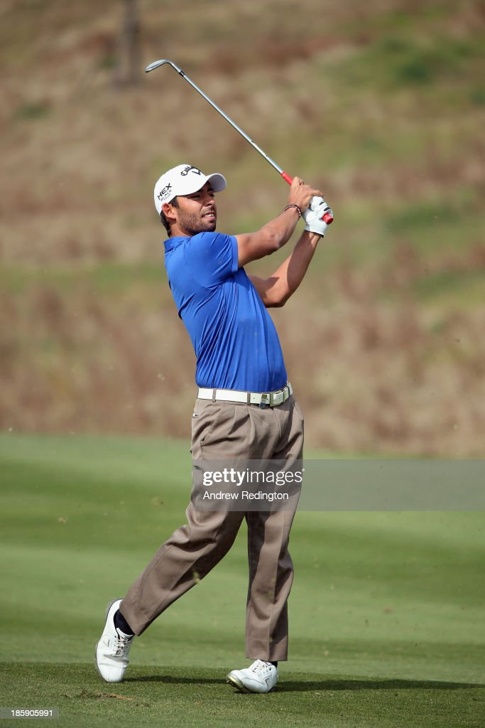 <a gi-track='captionPersonalityLinkClicked' href=/galleries/search?phrase=Pablo+Larrazabal&family=editorial&specificpeople=4022842 ng-click='$event.stopPropagation()'>Pablo Larrazabal</a> of Spain plays his second shot on the second hole during the third round of the BMW Masters at Lake Malaren Golf Club on October 26, 2013 in Shanghai, China.