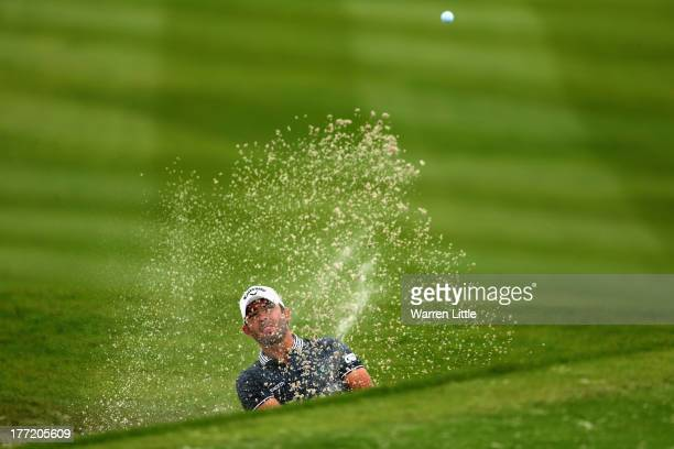 Pablo Larrazabal of Spain plays out of the 18th greenside bunker during the first round of the Johnnie Walker Championship at Gleneagles on August 22...