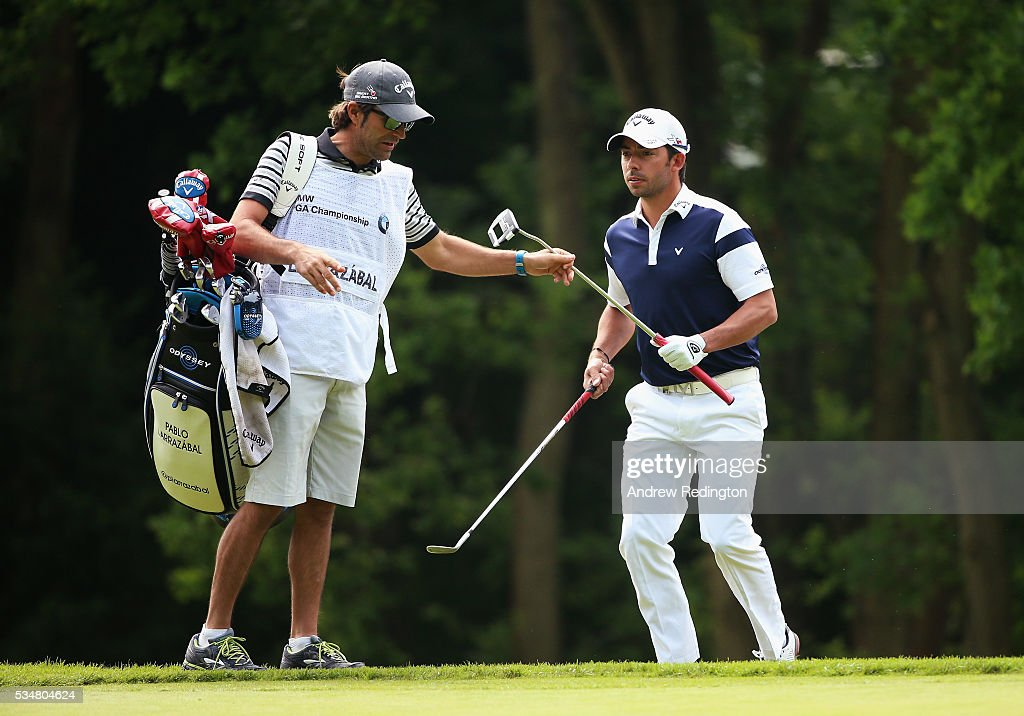 <a gi-track='captionPersonalityLinkClicked' href=/galleries/search?phrase=Pablo+Larrazabal&family=editorial&specificpeople=4022842 ng-click='$event.stopPropagation()'>Pablo Larrazabal</a> of Spain takes his putter from his caddie on the 1st hole during day three of the BMW PGA Championship at Wentworth on May 28, 2016 in Virginia Water, England.