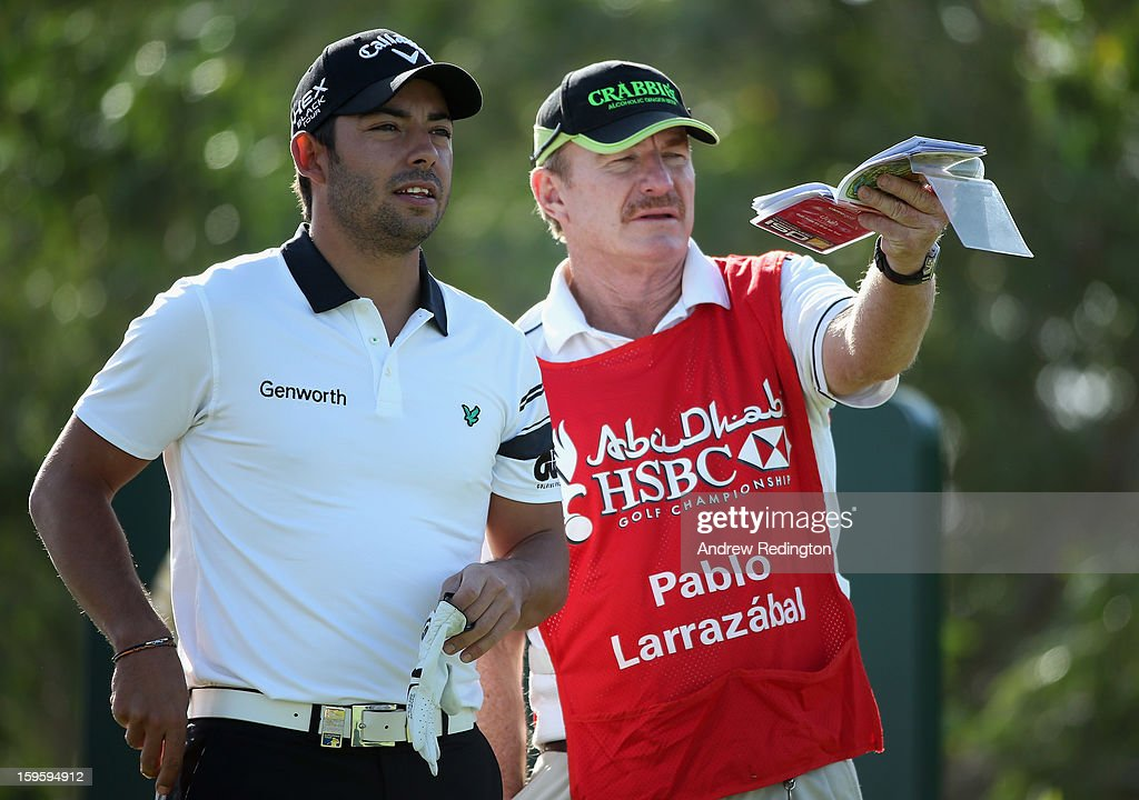 Pablo Larrazabal of Spain waits with his caddie <a gi-track='captionPersonalityLinkClicked' href=/galleries/search?phrase=John+Curtis&family=editorial&specificpeople=550280 ng-click='$event.stopPropagation()'>John Curtis</a> on the 16th hole during the first round of The Abu Dhabi HSBC Golf Championship at Abu Dhabi Golf Club on January 17, 2013 in Abu Dhabi, United Arab Emirates.