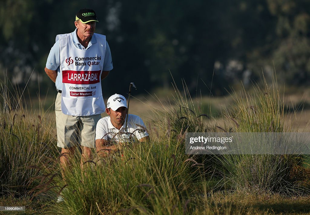 Pablo Larrazabal of Spain waits with his caddie <a gi-track='captionPersonalityLinkClicked' href=/galleries/search?phrase=John+Curtis&family=editorial&specificpeople=550280 ng-click='$event.stopPropagation()'>John Curtis</a> on the 12th hole during the first round of the Commercial Bank Qatar Masters held at Doha Golf Club on January 23, 2013 in Doha, Qatar.