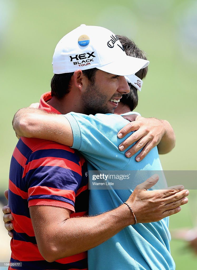 Pablo Larrzabal of Spain congratulates fellow countryman Eduardo de la Riva after his round during the second round of The Nelson Mandela Championship presented by ISPS Handa at Royal Durban Golf Club on December 9, 2012 in Durban, South Africa.