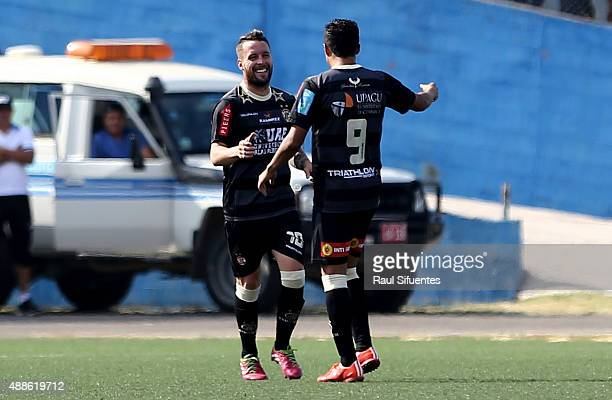 Pablo Lavandeira of UTC celebrates with his teammate after scoring the first goal of his team against Sporting Cristal during a match between UTC and...