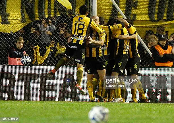 Pablo Lugüercio of Olimpo celebrates with his teammates after scoring his team's first goal during a match between Olimpo and River Plate as part of...