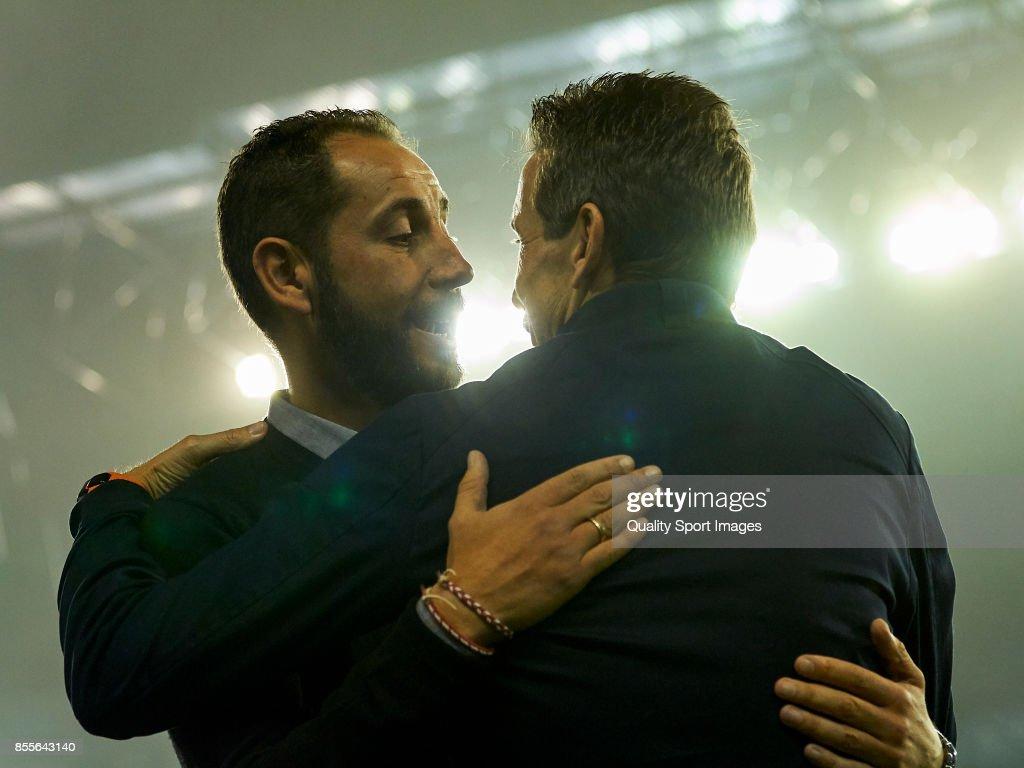 Pablo Machin (L) the manager of Girona FC talks with Juan Carlos Unzue the manager of Celta de Vigo prior to the La Liga match between Celta de Vigo and Girona at Balaidos Stadium on September 29, 2017 in Vigo, Spain.