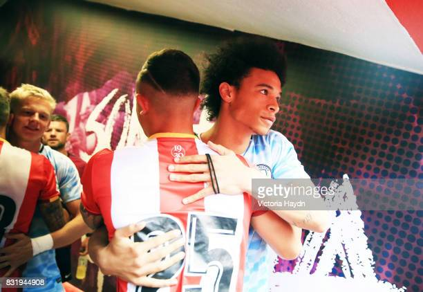 Pablo Maffeo greets Leroy Sane in the tunnel before the preseason friendly match between Girona and Manchester City at Municipal de Montilivi Stadium...