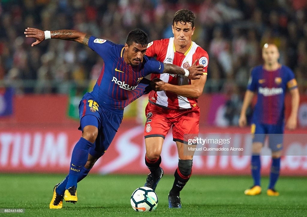 http://media.gettyimages.com/photos/pablo-maffeo-of-girona-competes-for-the-ball-with-paulinho-of-during-picture-id852441450