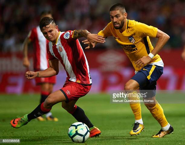 Pablo Maffeo of Girona competes for the ball with Yannick Carrasco of Atletico de Madrid during the La Liga match between Girona and Atletico de...