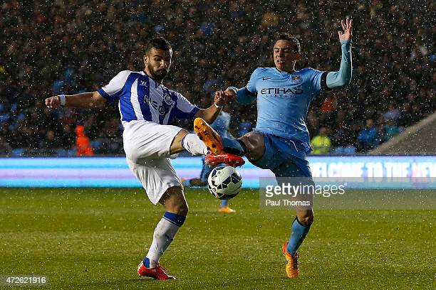 Pablo Maffeo of Manchester City in action with Leandro Silva of FC Porto during the Premier League International Cup Final match between Manchester...