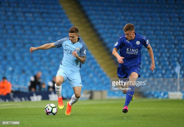 Pablo Maffeo of Manchester City is challenged by Harvey Barnes of Leicester City