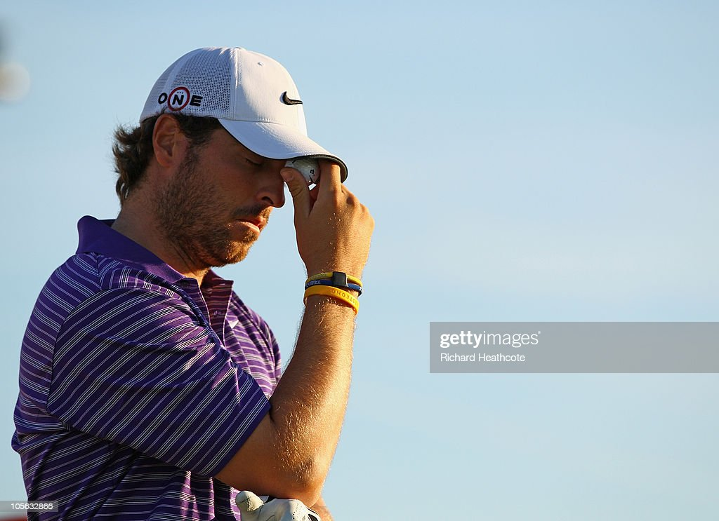 Pablo Martin of Spain reacts to hitting his tee shot into the water on the 18th during the final round of the Portugal Masters at the Oceanico...