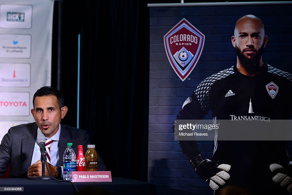 <a gi-track='captionPersonalityLinkClicked' href=/galleries/search?phrase=Pablo+Mastroeni&family=editorial&specificpeople=240329 ng-click='$event.stopPropagation()'>Pablo Mastroeni</a> addresses the media about <a gi-track='captionPersonalityLinkClicked' href=/galleries/search?phrase=Tim+Howard+-+Soccer+Player&family=editorial&specificpeople=11515558 ng-click='$event.stopPropagation()'>Tim Howard</a> as he is introduced as a member of the Colorado Rapids during a press conference at Dick's Sporting Goods Park on June 28, 2016.