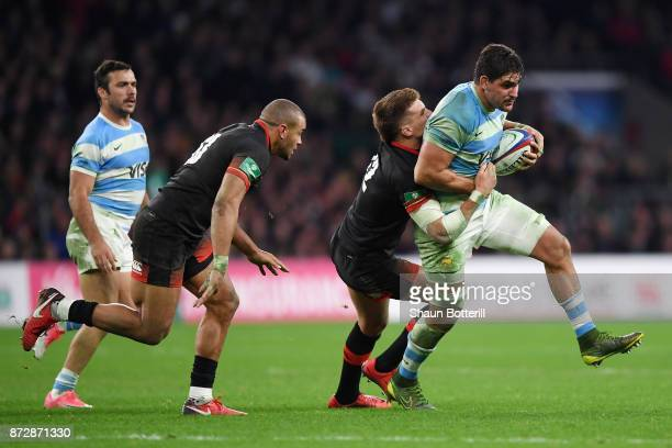 Pablo Matera of Argentina is tackled by Henry Slade of England during the Old Mutual Wealth Series match between England and Argentina at Twickenham...