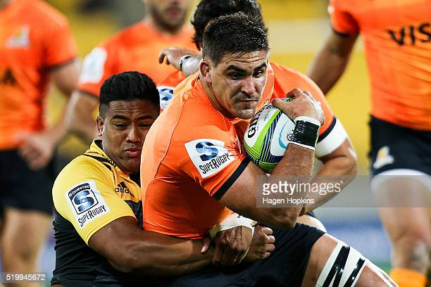 Pablo Matera of the Jaguares is tackled by Julian Savea of the Hurricanes during the round seven Super Rugby match between the Hurricanes and the...