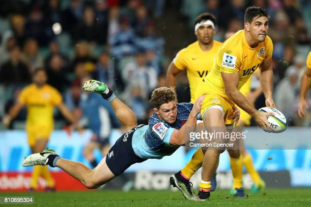 Pablo Matera of the Jaguares is tackled by Michael Hooper of the Waratahs during the round 16 Super Rugby match between the Waratahs and the Jaguares...