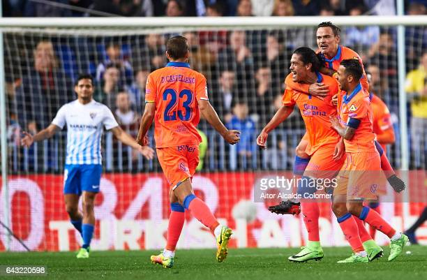 Pablo Mauricio Lemos of Union Deportiva Las Palmas celebrates after scoring with his team mates during La Liga match between Malaga CF and UD Las...