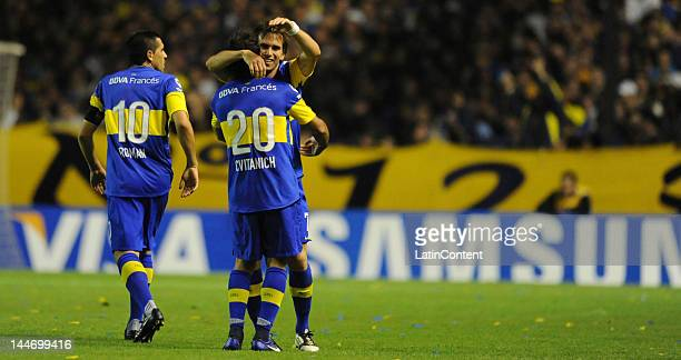 Pablo Mouche Boca Jrs forward celebrates a goal with Juan Roman Riquelme and Dario Cvitanich during a match between Boca and Fluminense as part of...