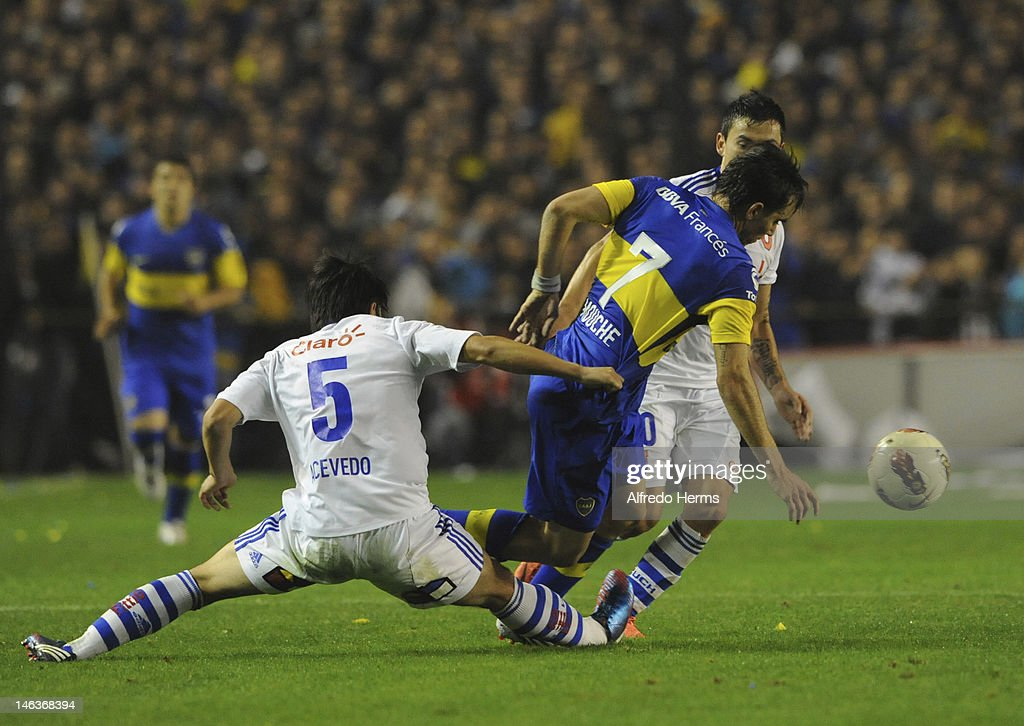 Pablo Mouche, of Boca Juniors, fights for the ball with Albert Acevedo, of Universidad de Chile, during the first leg of the Copa Libertadores 2012 semi-finals between Boca Jrs and Universidad de Chile at Bombonera Stadium on June 14, 2012 in Buenos Aires, Argentina.