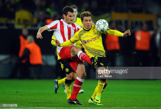Pablo Orbaiz of Olympiacos challenges Mario Goetze of Dortmund during the UEFA Champions League group F match between Borussia Dortmund and...