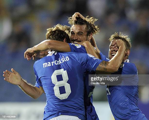 Pablo Osvaldo of Italy celebrates with teammate Claudio Marchisio after scoring the opening goal of the FIFA 2014 World Cup Qualifier match between...