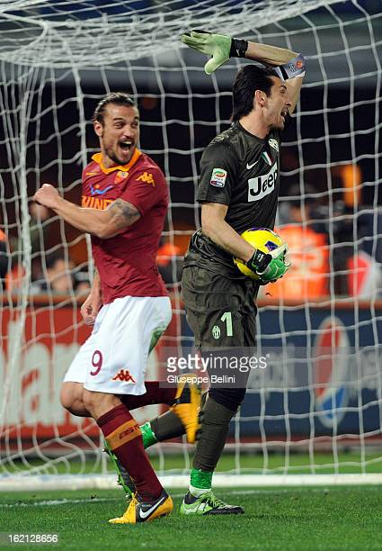Pablo Osvaldo of Roma and Gianluigi Buffon of Juventus after the opening goal of Francesco Totti during the Serie A match between AS Roma and...