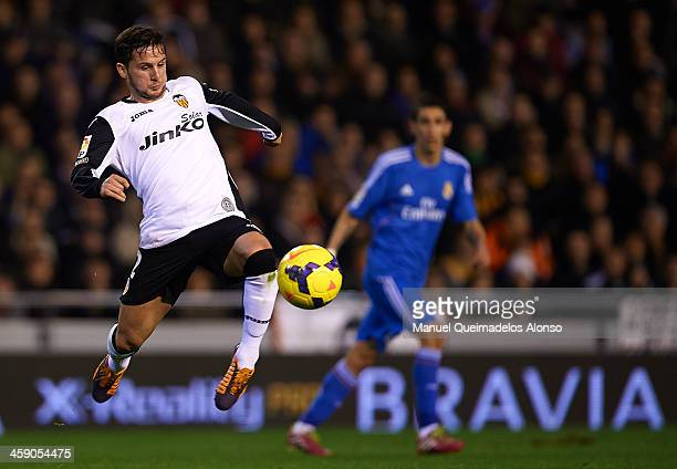 Pablo Paitti of Valencia in action during the La Liga match between Valencia CF and Real Madrid CF at Estadio Mestalla on December 22 2013 in...