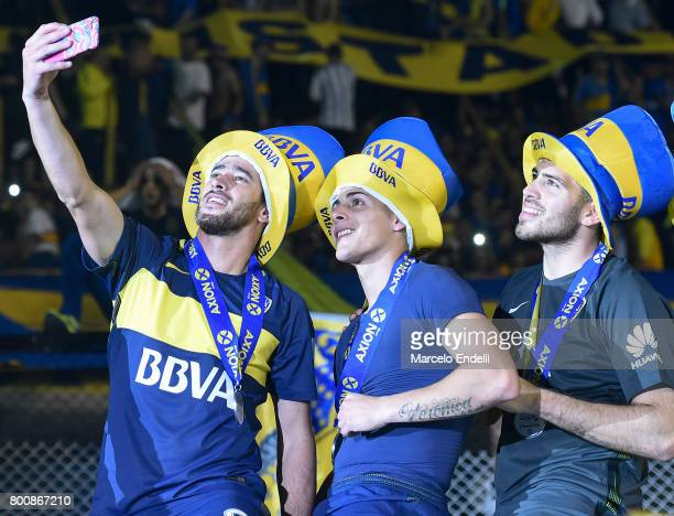 Pablo Perez Cristian Pavon and Agustin Rossi of Boca Juniors take a selfie photo to celebrate after a match between Boca Juniors and Union as part of...