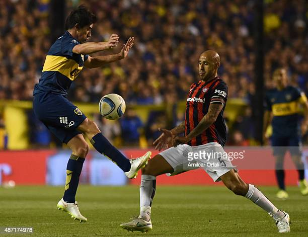 Pablo Perez of Boca Juniors and Juan Ignacio Mercier of San Lorenzo figth for the ball during a match between Boca Juniors and San Lorenzo as part of...