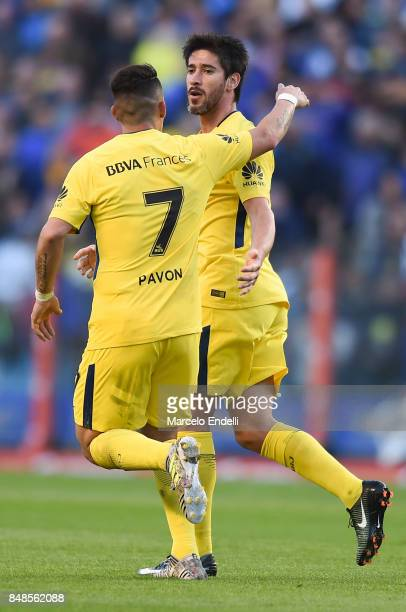 Pablo Perez of Boca Juniors celebrates with teammate Cristian Pavon after scoring the first goal of his team during a match between Boca Juniors and...