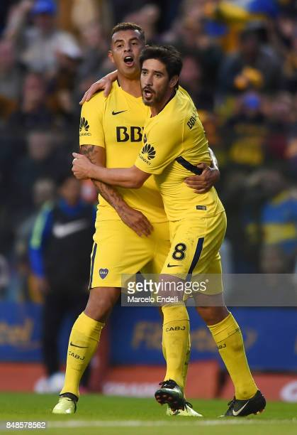 Pablo Perez of Boca Juniors celebrates with teammate Edwin Cardona after scoring the second goal of his team during a match between Boca Juniors and...