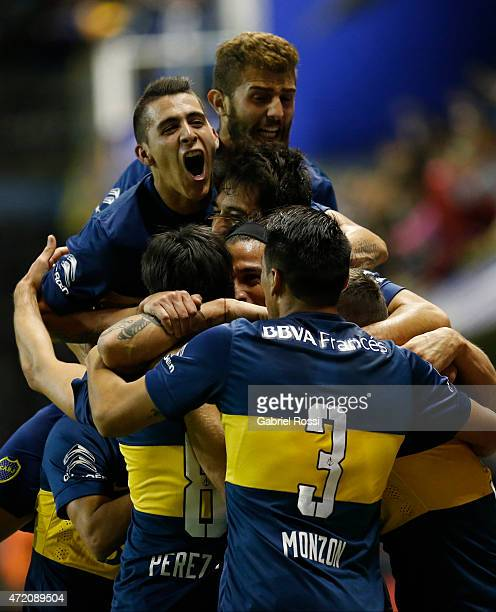 Pablo Perez of Boca Juniors celebrates with teammates after scoring his team's second goal during a match between Boca Juniors and River Plate as...