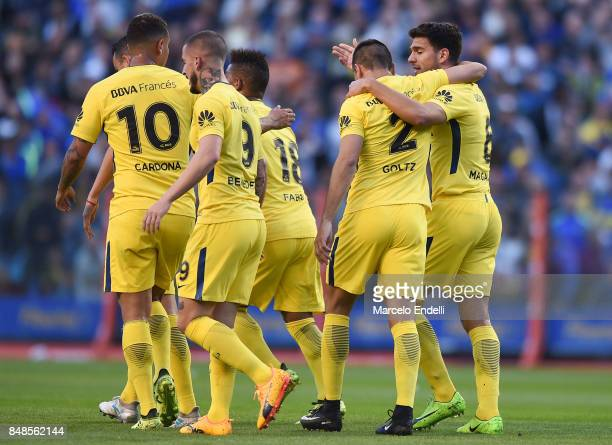 Pablo Perez of Boca Juniors celebrates with teammates after scoring the first goal of his team during a match between Boca Juniors and Godoy Cruz as...