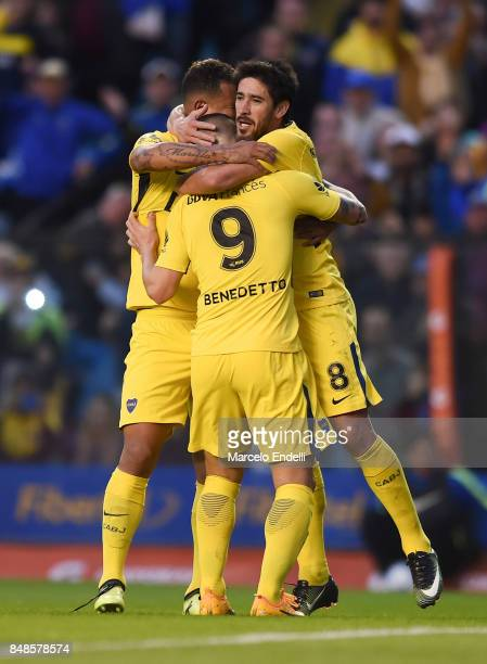 Pablo Perez of Boca Juniors celebrates with teammates Edwin Cardona and Dario Benedetto after scoring the second goal of his team during a match...